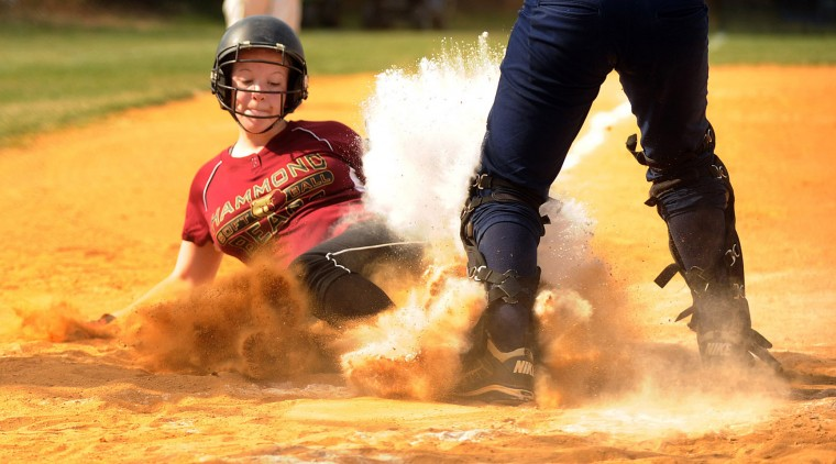 Emily Speierman of Hammond kicks up dirt and chalk as she slides safely into home for a run during a game at Marriotts Ridge High School in Marriottsville on Wednesday, April 10, 2013. (Brian Krista/BSMG)