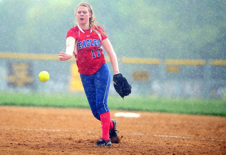 Centennial's Emily Bowman delivers a pitch in the rain of a quickly passing storm during a regional playoff game at Mount Hebron High School in Ellicott City on Thursday, May 9, 2013. (Brian Krista/BSMG)