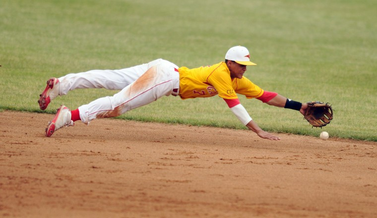 Calvert Hall shortstop Richard Rodriguez comes up just short as he dives for a ground ball during the MIAA A Conference baseball championship game at Ripken Stadium in Aberdeen on Sunday, May 19, 2013. (Brian Krista/BSMG)