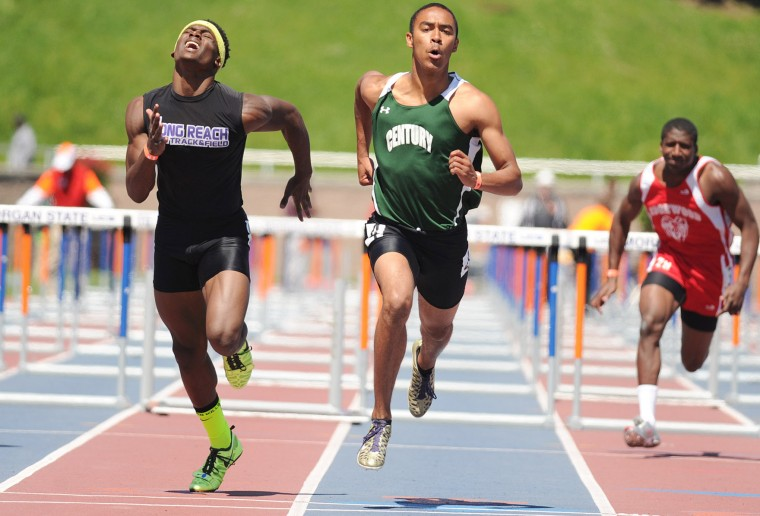 Robert Carter of Long Reach, left, comes up just short behind Century's Julian Wood as they come to the finish of the 2A boys 110 meter hurdles during the Maryland state track and field championships at Morgan State University in Baltimore on Saturday, May 25, 2013. (Brian Krista/BSMG)