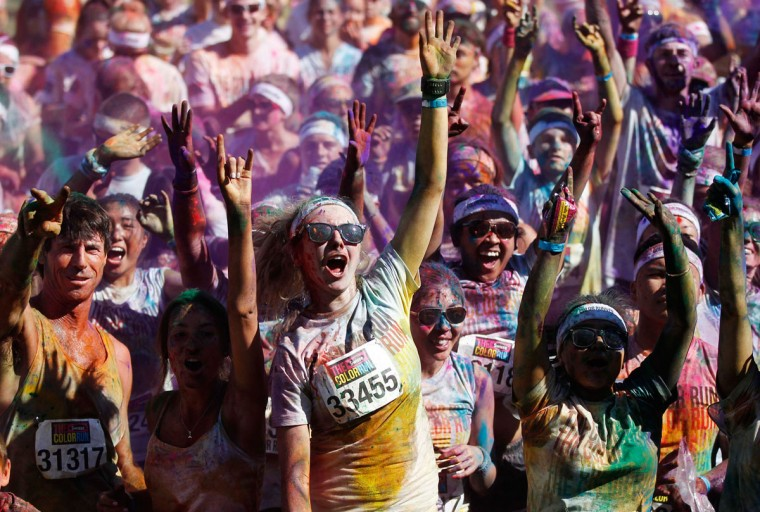 Runners cheer after finishing the Color Run in Sydney, Australia, in February. (Daniel Munoz/Reuters)