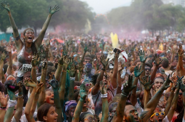 Runners celebrate after the Color Run in Rio de Janeiro, Brazil, in December. (Ricardo Moraes/Reuters)