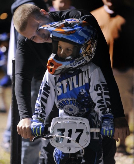 Racer Brandon Carroll gives his young brother Colin Baldwin (age 4 1/2) some pointers before he climbs up to the starting gate at the Chesapeake BMX track in Severn, Md. (Gene Sweeney Jr./Baltimore Sun Photo)