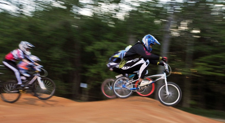 Rolando Camacho leads the pack on a practice run in preparation for the night's races at the Chesapeake BMX track in Severn. (Gene Sweeney Jr./Baltimore Sun Photo)