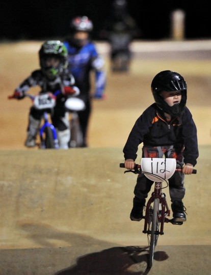 "Five-year-old Bradley Hewitt leads his ""5 and Under Novice"" group to the finish line during practice last Friday night at Chesapeake BMX in Severn. (Gene Sweeney Jr./Baltimore Sun)"