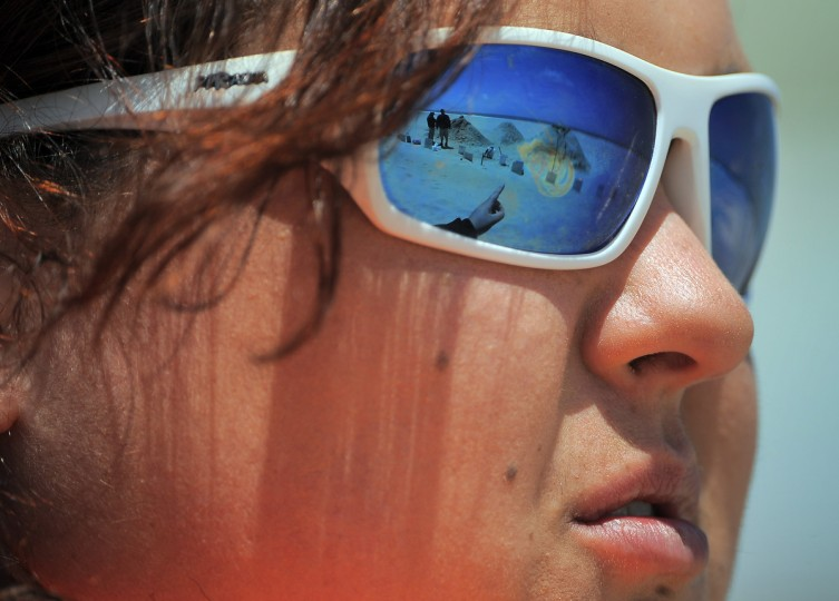 Sand sculpture work is reflected in the sunglasses of Rebecca Deems of Fairmont, WV, created by minister artist Randy Hofman. (Karl Merton Ferron/Baltimore Sun)