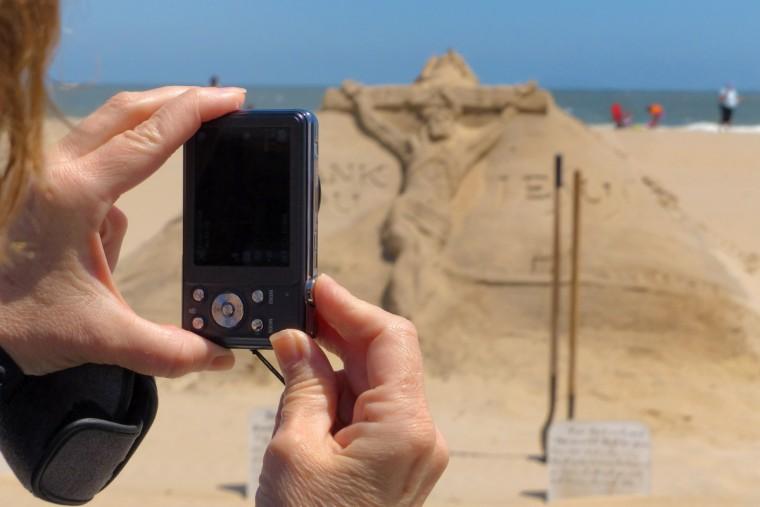 Minister artist Randy Hofman at the Ocean City Boardwalk, where he regularly creates biblical sand sculptures. (Karl Merton Ferron/Baltimore Sun)