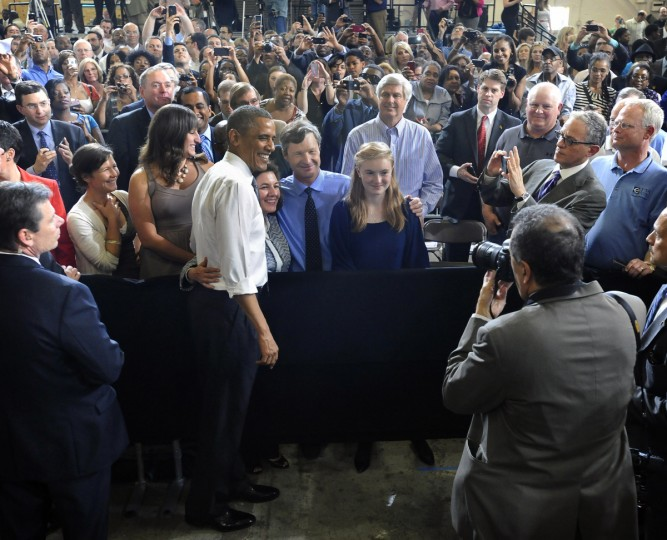President Obama, center left, poses for pictures with Ellicott Dredges CEO Peter Bowe's family after delivering remarks to company employees and vendors. (Kenneth K. Lam/Baltimore Sun)