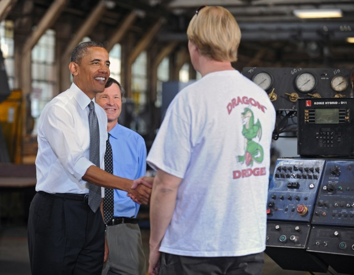 While in Baltimore during a tour of Ellicott Dredges guided by company CEO Peter Bowe, center, President Obama, left, met Michael Aus, right, of Reisterstown, Md., a CNC Burn Table operator. Ellicott Dredges is a local manufacturer of innovative dredging equipments which are being used worldwide for infrastructure projects. (Kenneth K. Lam/Baltimore Sun)
