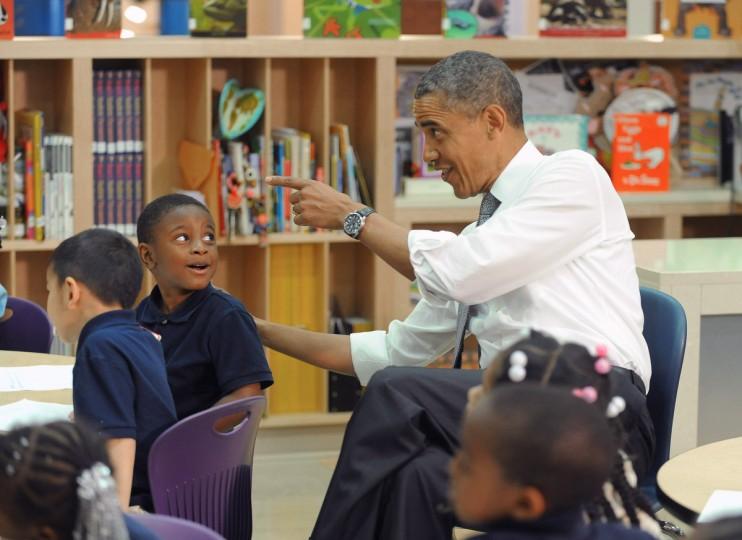 President Barak Obama visits with pre-kindergarden students at Moravia Park Elementary School. (Kenneth K. Lam/Baltimore Sun)