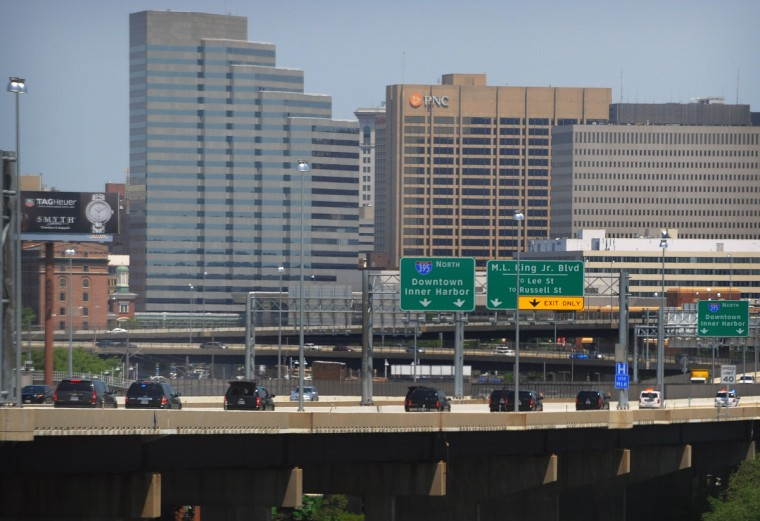 The Presidential motorcade drive on I-395 on-the-way to the second stop of President Barak Obama's three-stop Middle Class Jobs and Opportunity Tour in Baltimore. While in Baltimore, the president sat-in with pre-kindergarden students at Moravia Park Elementary School, gave a speech at Ellicott Dredges, a local manufacturer of innovative dredging equipments and visited the Center for Urban Families. (Kenneth K. Lam/Baltimore Sun)