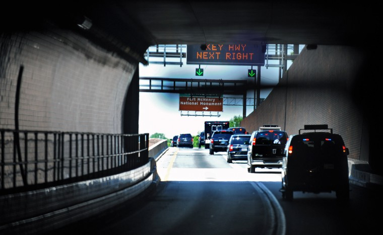 The Presidential motorcade drives through the Fort McHenry tunnel on-the-way to the second stop of President Barak Obama's three-stop Middle Class Jobs and Opportunity Tour in Baltimore. (Kenneth K. Lam/Baltimore Sun)