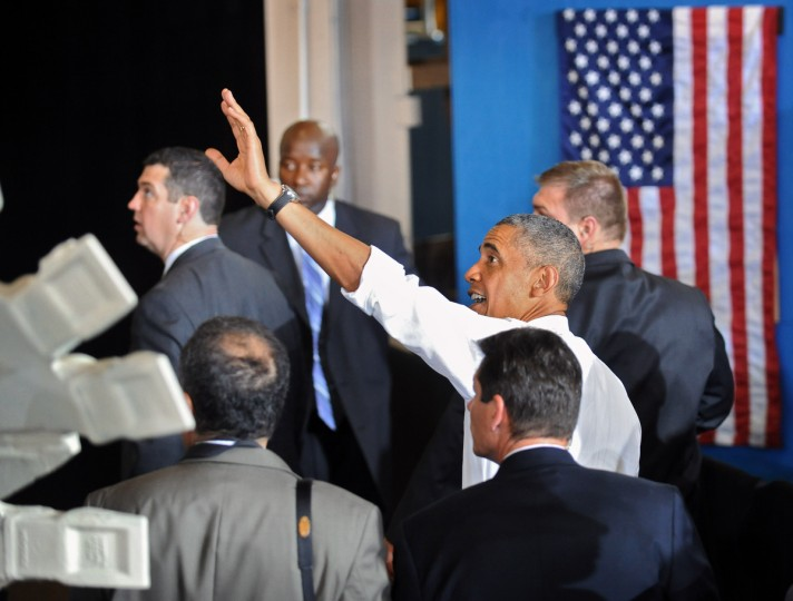 President Obama waves to the crowd as he leaves after delivering remarks to Ellicott Dredges employees and vendors. (Kenneth K. Lam/Baltimore Sun)