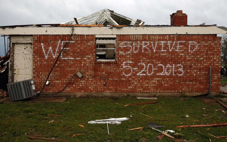A survivor sign is shown written on a home in Moore, Oklahoma, Tuesday, May 21, 2013. A massive tornado swept through the south Oklahoma City suburb Monday afternoon. (Brad Loper/Dallas Morning News/MCT)