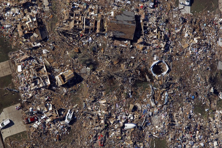 An aerial view of destroyed houses after a powerful tornado ripped through the area on May 21, 2013 in Moore, Oklahoma. The town reported a tornado of at least EF4 strength and two miles wide that touched down yesterday killing at least 24 people and leveling everything in its path. U.S. President Barack Obama promised federal aid to supplement state and local recovery efforts. (Benjamin Krain/Getty Images)
