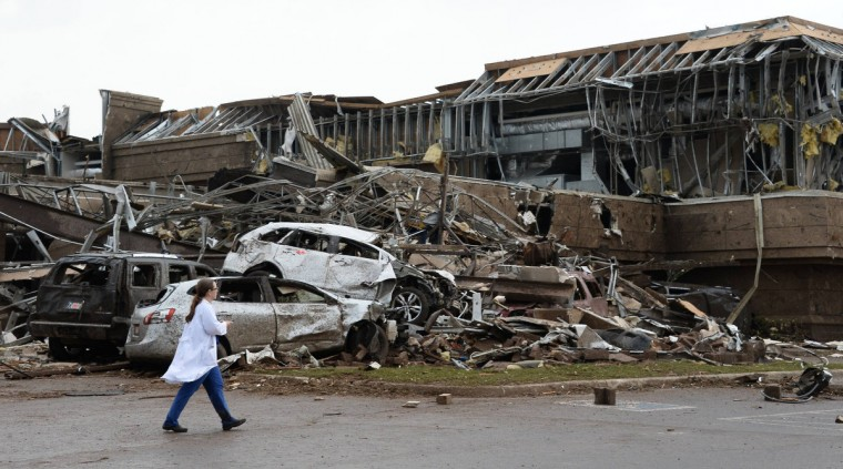 A nurse walks the destruction at Moore hospital after a huge tornado struck Moore, Oklahoma, near Oklahoma City, May 20, 2013. A huge tornado with winds of up to 200 miles per hour (320 kph) devastated the Oklahoma City suburb of Moore on Monday, ripping up at least two elementary schools and a hospital and leaving a wake of tangled wreckage. (Gene Blevins/Reuters photo)