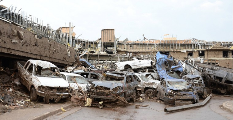 Dozens of cars piled up on top of each other in the parking lot of Moore Hospital after a tornado struck Moore, Oklahoma, May 20, 2013. A huge tornado with winds of up to 200 miles per hour (320 kph) devastated the Oklahoma City suburb of Moore on Monday, ripping up at least two elementary schools and a hospital and leaving a wake of tangled wreckage. (Gene Blevins/Reuters photo)