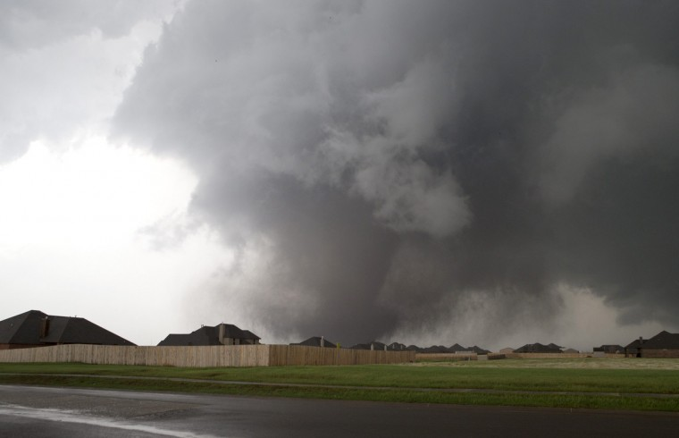 A huge tornado approaches the town of Moore, Oklahoma, near Oklahoma City, May 20, 2013. A massive tornado tore through the Oklahoma City suburb of Moore on Monday, killing at least 51 people as winds of up to 200 miles per hour (320 kph) flattened entire tracts of homes, two schools and a hospital, leaving a wake of tangled wreckage. (Richard Rowe/Reuters photo)