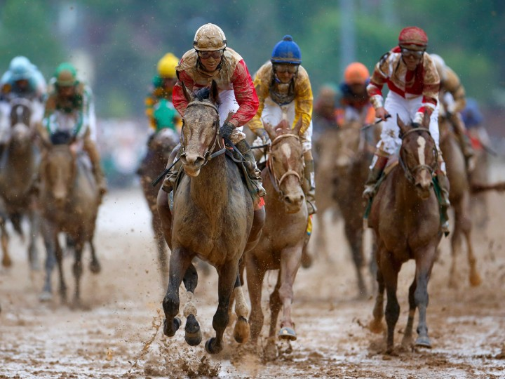 Orb, ridden by jockey Joel Rosario, wins the 139th Kentucky Derby on a sloppy track at Churchill Downs. (John Gress/Reuters)