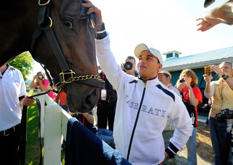 Jockey Joel Rosario greets Orb on Friday at Pimlico Race Course. (Lloyd Fox/Baltimore Sun Photo)