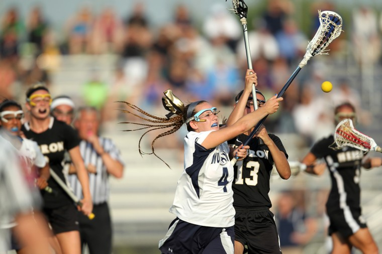 Marriotts Ridge's Alexis Zadjura, left, and Mount Hebron's Kieran Kelleher, right, battle for the ball during the regional final girls lacrosse game at Marriotts Ridge High School in Marriottsville on Wednesday, May 15, 2013. (Jen Rynda/BSMG)