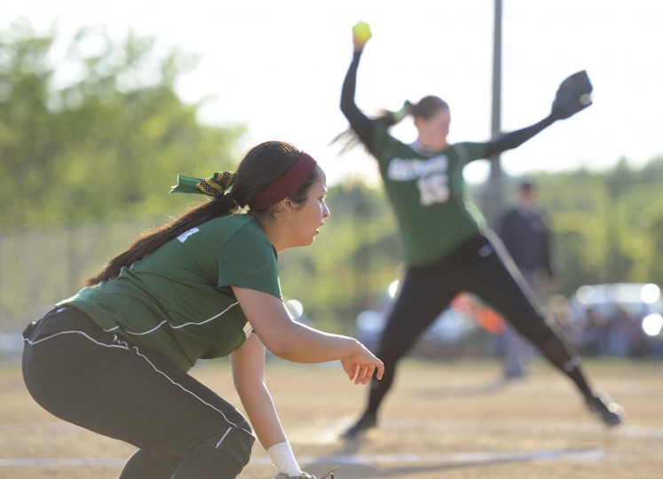 Seton Keough third baseman Lori Sena, left, prepares for some action while Hannah Tavik pitches. (Jon Sham/BSMG)