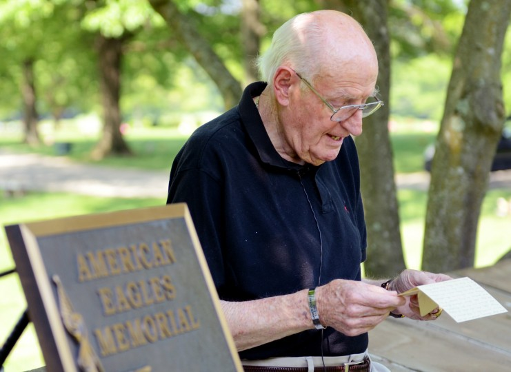 Tom Sheehan, a Korean War veteran and North County resident, sits in front of a veteran's memorial at Dulaney Valley Memorial Gardens in Timonium on Tuesday, May 21, 2013 reading the letter he wrote to his children decades ago about the importance of Memorial Day.