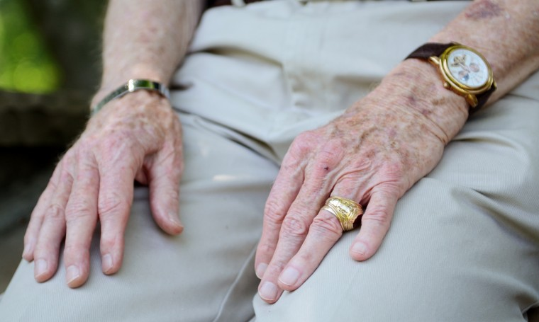 A close-up of Tom Sheehan's hands.