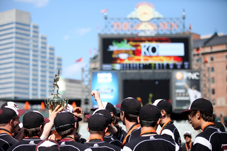 Curley players hold up the President's Cup after beating Gilman in the baseball finals of the Baltimore President's Cup at Oriole Park at Camden Yards in Balitmore on Saturday, April 13, 2013. (Jen Rynda/BSMG)
