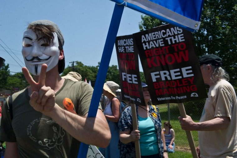 People gather on June 1, 2013 for a demonstration in support of US Army Private Bradley Manning at Fort Meade in Maryland, where Manning's court martial will begin on June 3. (Nicholas Kamm / AFP / Getty Images)