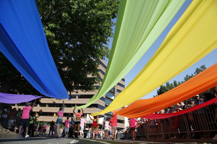 Participants carry rainbow banners during the Capital Pride Parade in Washington, June 8, 2013. (Jonathan Ernst / Reuters)