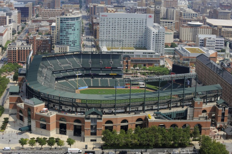 Oriole Park at Camden Yards along with the recently constructed Hilton Hotel are seen in this aerial view in 2009. (Lloyd Fox, The Baltimore Sun)