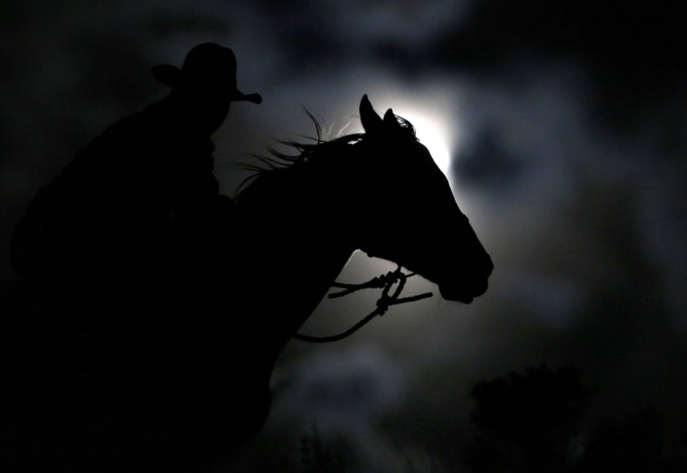 "Wrangler Nate Cummins takes the opportunity to ride by moonlight, the night before the ""supermoon"" during Montana Horses' annual horse drive outside Three Forks, Montana, May 4, 2012. (Jim Urquhart/Reuters)"