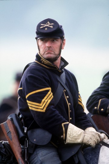 Reenactment of the Battle of Gettysburg: Bill Raymond of the U.S. Cavalry rides during a reenactment in 2003. (Robert London / Special to The Baltimore Sun)