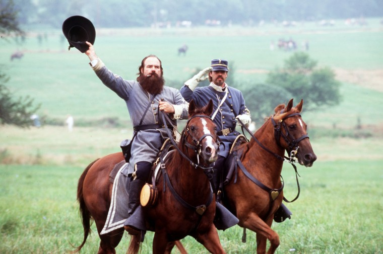 Reenactment of the Battle of Gettysburg: General James Longstreet, portrayed by veteran reenactor, Ron Hawkins, and Major Moxley Sorrel, portrayed by Ron's son Eric, salute the troops in 2003. (Robert London / Special to The Baltimore Sun)