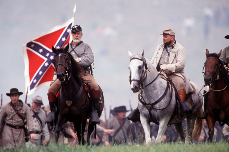 Reenactment of the Battle of Gettysburg: William C. Oates, commander of the 15th Alabama Regiment leads his troops toward the Round Tops, unaware that Little Round Top is now occupied by Union forces in 2003. (Robert London / Special to The Baltimore Sun)