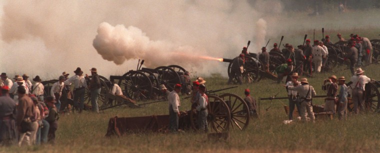 Reenactment of the Battle of Gettysburg: A Confederate artillery battery fires during a reenactment of Hood's Advance Saturday morning in 1999. (Jerry Jackson / The Baltimore Sun)