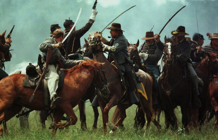 Reenactment of the Battle of Gettysburg: Union and Confederate cavalry troops engage in close combat during a reenactment in 1998. (Chiaki Kawajiri / The Baltimore Sun)