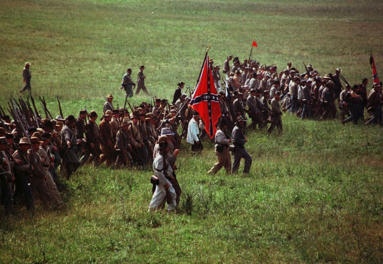 Reenactment of the Battle of Gettysburg: Confederate infantry march across the battlefield towards the Union position during a reenactment in 1998. (Chiaki Kawajiri / The Baltimore Sun)