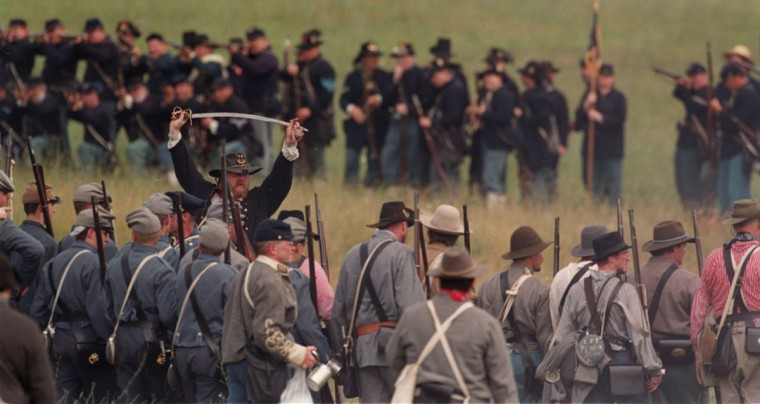 Reenactment of the Battle of Gettysburg: Confederate and Union troops meet on the battlefield during a reenactment in 1999. (Jerry Jackson / The Baltimroe Sun)