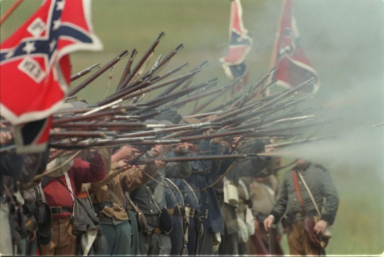 Reenactment of the Battle of Gettysburg: Confederate troops fire towards the Union soldiers during a reenactment in 1999. (Jerry Jackson / The Baltimore Sun)