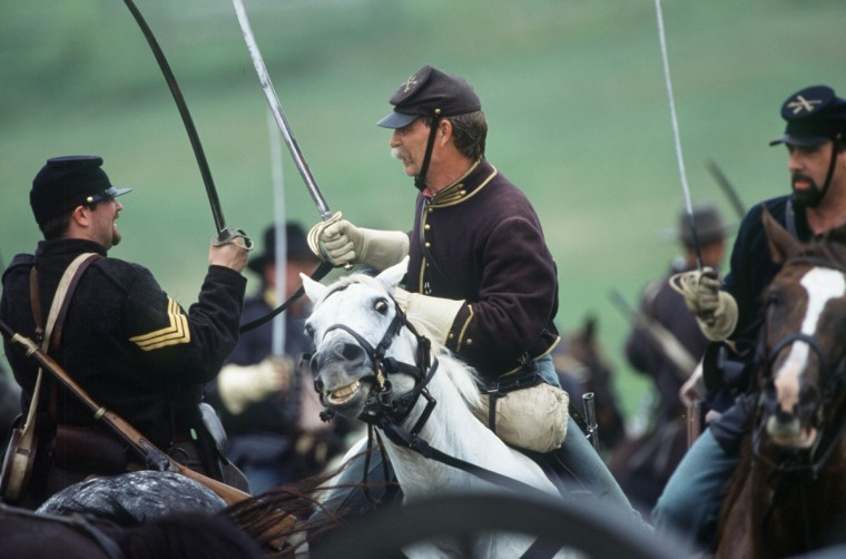 Reenactment of the Battle of Gettysburg: Union and Confederate cavalrymen fight a fierce mounted battle during a reenactment in 2001. (Robert London / Special to The Baltimore Sun)