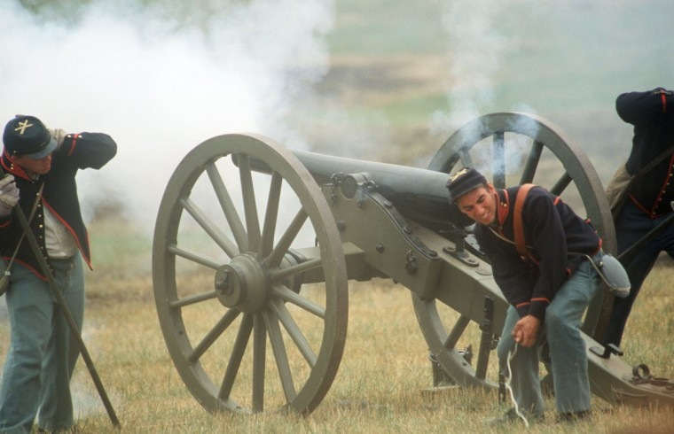 Reenactment of the Battle of Gettysburg: Union artillery fires back during a reenactment in 2002. (Robert London / Special to The Baltimore Sun)