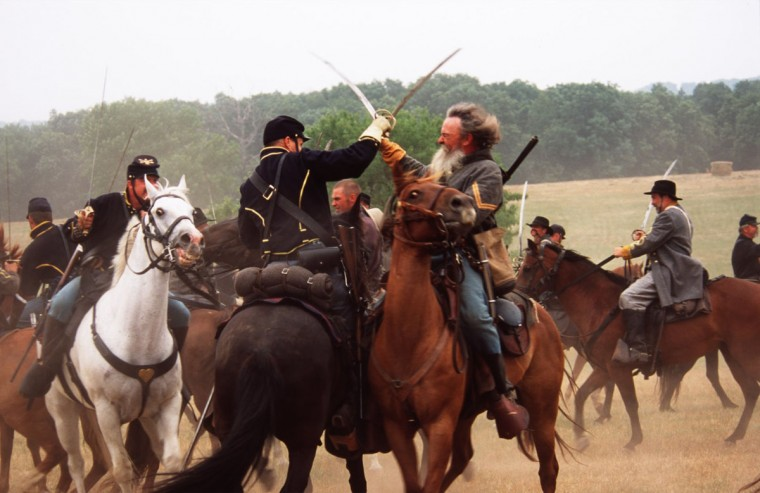 Reenactment of the Battle of Gettysburg: A full scale cavalry battle is made up of many one-to-one actions during a reenactment in 2002. (Robert London / Special to The Baltimore Sun)