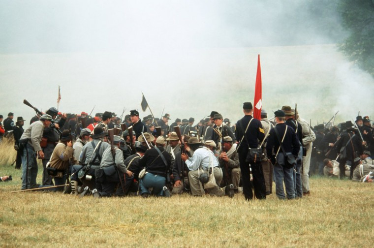 Reenactment of the Battle of Gettysburg: Almost all of the Confederate infantrymen who breached the Angle are either killed or captured during a reenactment in 2002. (Robert London / Special to The Baltimore Sun)