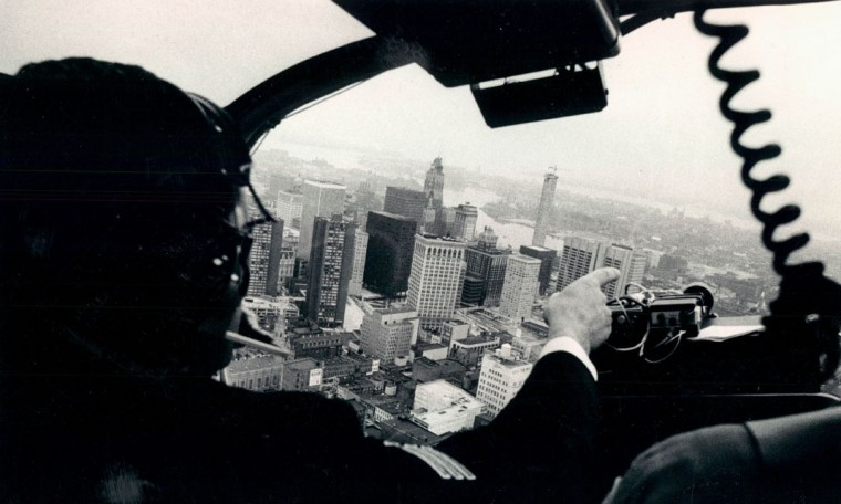 Baltimore police officer Regis Raffensberger pilots a helicopter above the city in 1971. (Carl D. Harris / The Baltimore Sun)