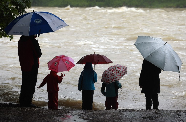 People watch the rising Lech river on June 2, 2013 in Landsberg am Lech, Germany. Heavy rains across portions of Germany are causing flooding and ruining crops. (Johannes Simon/Getty Images)
