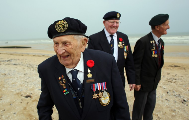 Normandy veterans (L-R) Victor Urch, 88 and Frank Baugh, 89 (who were in the Royal Navy dropping troops and supplies onto Sword Beach) and Derek Whitehead, 88 (who was in the Durham Light Infantry and was on Gold Beach on D-Day) share a joke as they walk along what was the British Sword beach at Colleville Montgomery on June 5, 2013 near Caen, France. Across Normandy several hundred of the surviving veterans of the Normandy campaign are gathering to commemorate the 69th anniversary of the D-Day landings which eventually led to the Allied liberation of France in 1944. Next year, which will mark the 70th anniversary of the landings, is widely expected to be the last time that the veterans will gather in any great number. (Matt Cardy/Getty Images)
