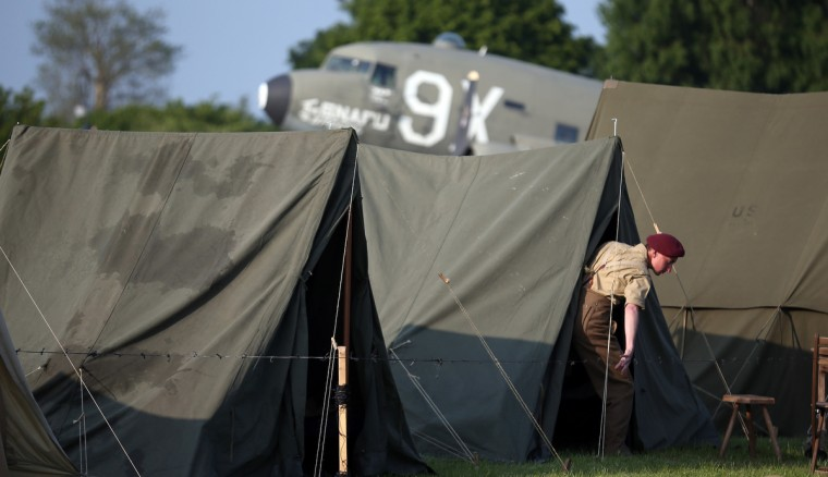A man dressed as a British Second World War soldier leaves a tent at the Merville Gun Battery near Caen, France. Across Normandy several hundred of the surviving veterans of the Normandy campaign are gathering to commemorate the 69th anniversary of the D-Day landings which eventually led to the Allied liberation of France in 1944. (Matt Cardy/Getty Images)