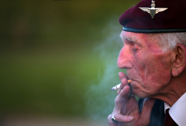 Normandy veteran Douglas Baines, 89, (who was a paratrooper dropped into Normandy in the early hours of D-Day) smokes a cigarette. (Matt Cardy/Getty Images)
